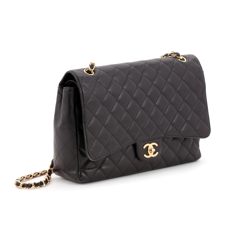 47dc56c7 CHANEL, a black caviar leather shoulder bag,