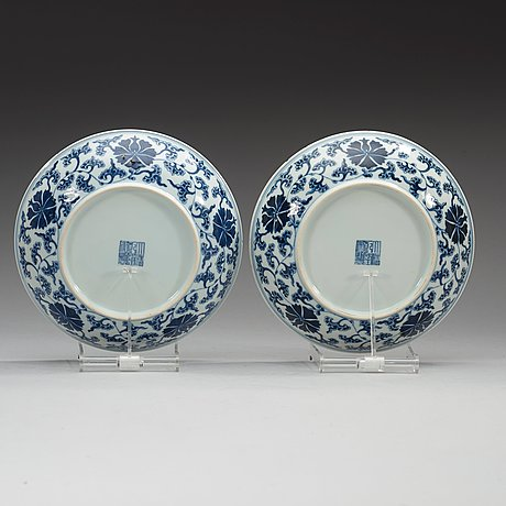 A pair of blue and white lotus dishes, qing dynasty (1644-1912) with qianlong seal mark.