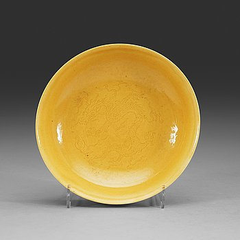 4. A Yellow glazed dish, Qing dynasty, with Daoguang seal mark and period (1821-1850).