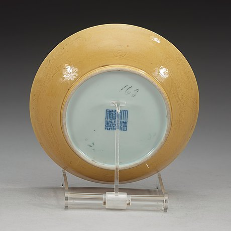 A yellow glazed dish, qing dynasty, with daoguang seal mark and period (1821-1850).