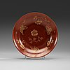 A cappuciner brown dish decorated in gold, qing dynasty (1644-1912) with qianlongs seal mark.