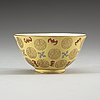 A yellow bowl, qing dynasty, with tongzhi four character mark in red.
