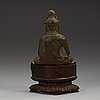 A seated bronze figure of guanyin, ming dynasty (1368-1644).