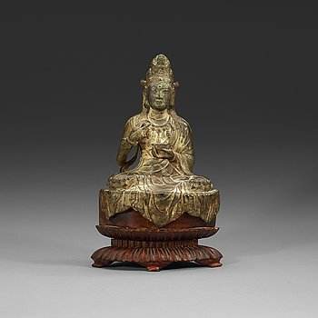 88. A seated bronze figure of Guanyin, Ming dynasty (1368-1644).