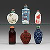 A set of six porcelain, red lacquer and glass snuff bottles, late qing dynasty(1644-1912)/early republic (1912-1949).