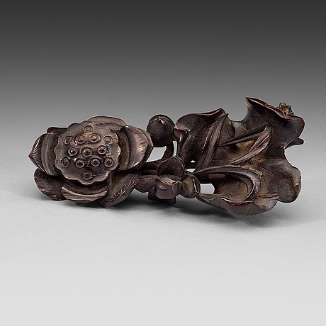 "A finely carved zitan ""lotus"" stand, qing dynasty (1644-1912)."
