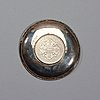 A small silver plate with a one dollar coin, qing dynasty, guangxu 1899.