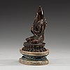 A copper alloy seated figure of a tsong khapa, presumably nepal, 19th century or older.
