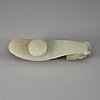 A carved white nephrite belt hook, qing dynasty (1644-1912).