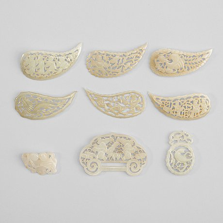A set of nine carved white nephrite pendants and leafs, late qing dynasty (1644-1912).