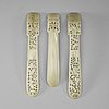 Three pale celadon carved nephrite hair adornments, late qing dynasty (1644-1912).