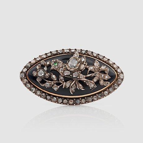 A late victorian rose-cut diamond and dark blue enamel brooch.
