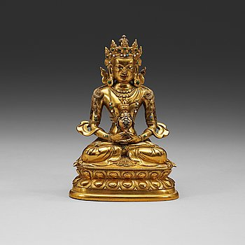 216. A stone inlayed gilt bronze figure of Amitayus, seated in meditation on a double lotus base, Qing dynasty, 18th Century.