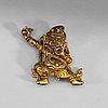 A sinotibetan gilt bronze miniature standing figure of a dharmapala, presumably 18th century.