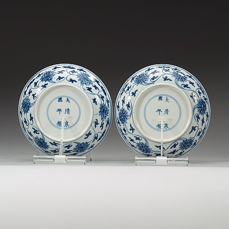 A pair of blue and white lotus dishes, qing dynasty (1644-1912) with kangxi six characters mark.