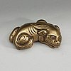 A bronze paper-weight modeled as a reclining lion, qing dynasty, presumably 18th century.