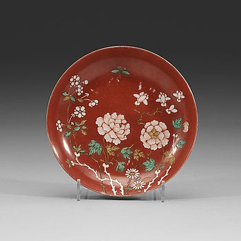 1. An enamelled coral-gorund dish, Qing dynasty with Daoguangs seal mark and period (1821-1850).