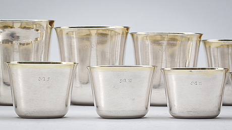 A set of 12 swedish early 18th century parcel-gilt hunting-beakers and cover, marks of petter henning, stockholm 1707.