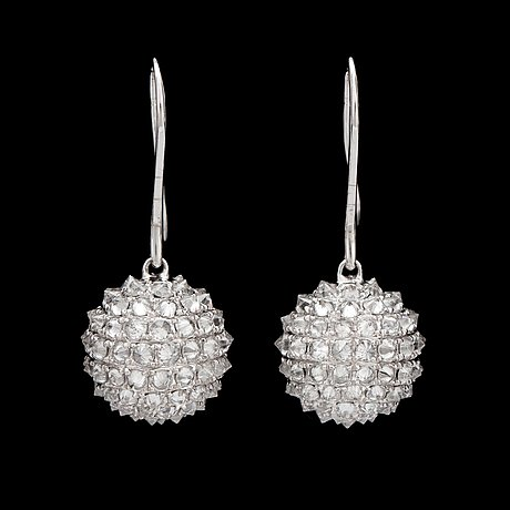 A pair of diamond, circa 4.87 cts in total, earrings.