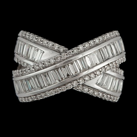 A brilliant- and baguette-cut diamond ring. total carat weight circa 1.50 cts.