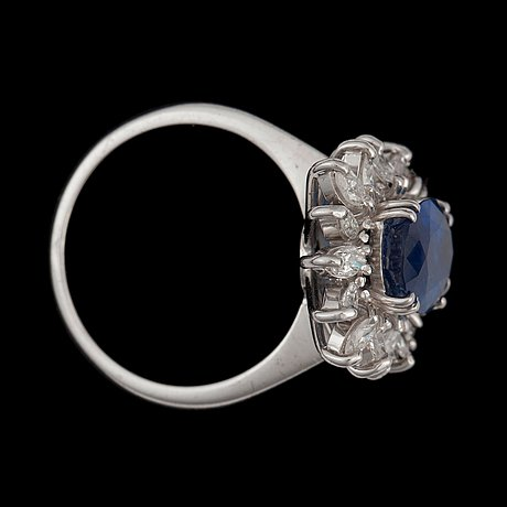 A sapphire and diamond ring. total carat weight of diamonds circa 1.00 ct.