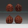 Two pairs of carved walnut hand exercisers, late qing dynasty (1644-1912).