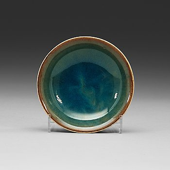 9. A bluish brown glazed small porcelain bowl, late Qing dynasty.