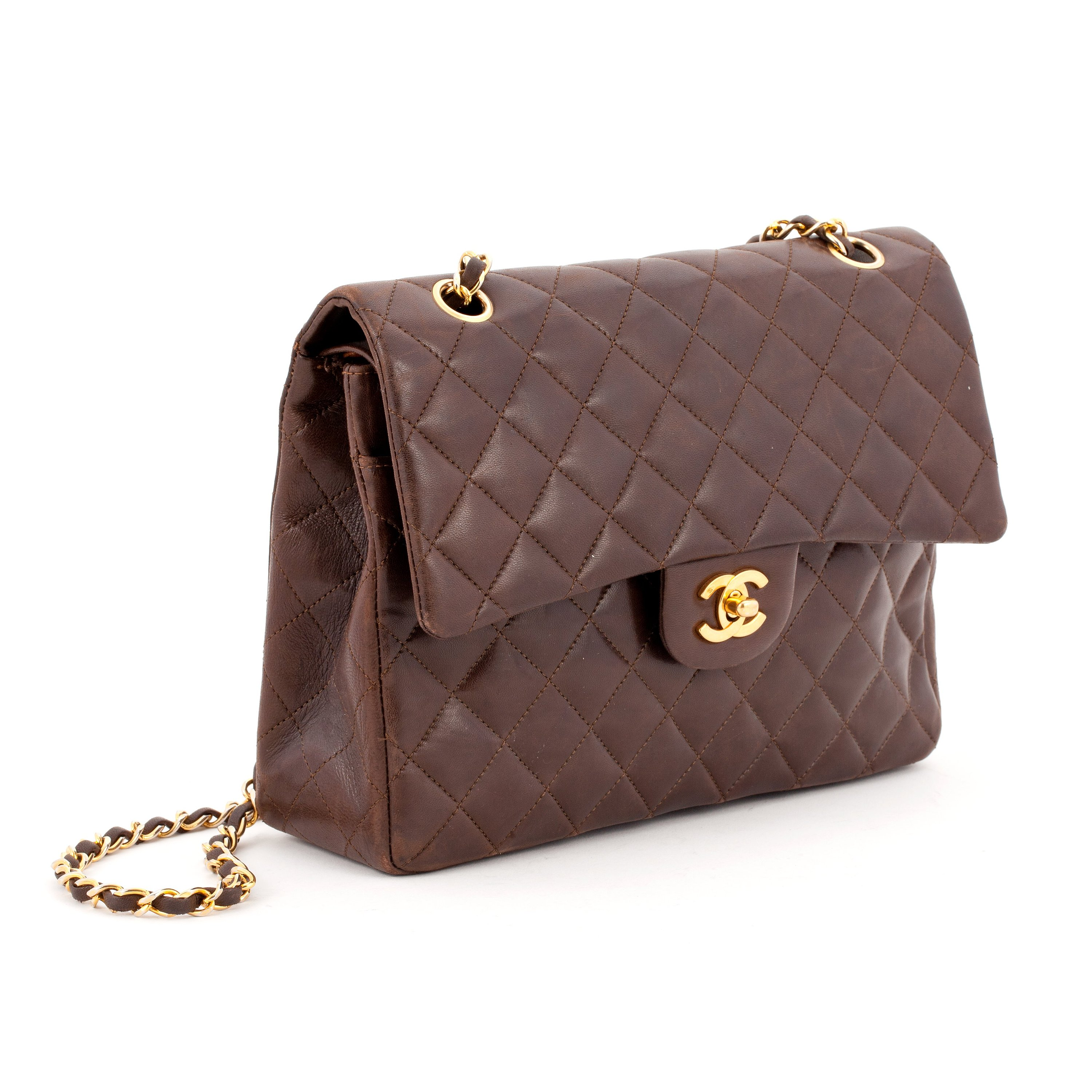 ad6e55de15b03c CHANEL, a quilted brown leather purse,
