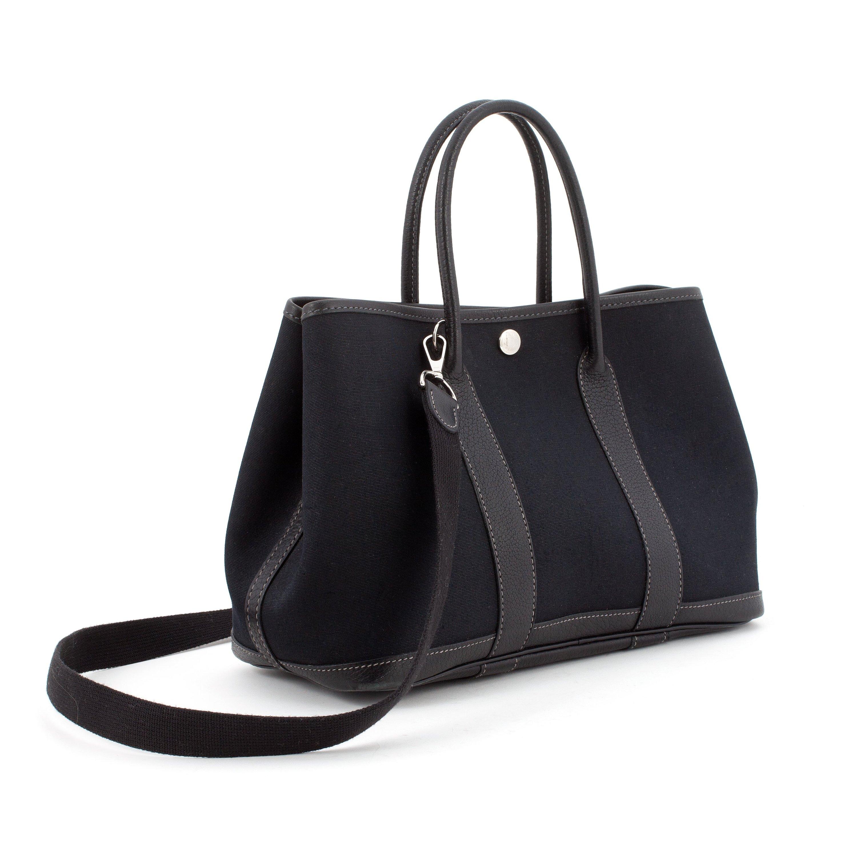 7ff83c3ff96 HERMÈS, a black canvas and leather bag,