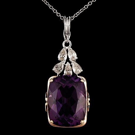 An amethyst and diamond pendant, with chain. amethyst 18.00 cts. diamonds 1.00 ct.