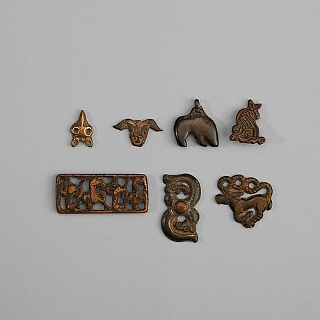 A set of seven bronze pendants and garment plaques, ordo, warring states (481-221 bc).