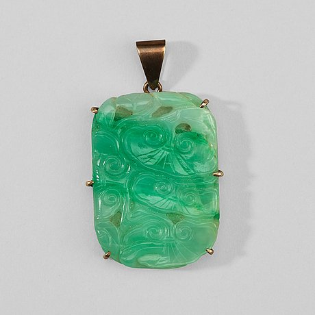 A carved jadeite pendant with lingzhi mushrooms, early 20th century.