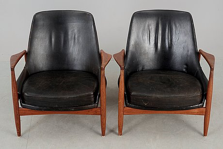 A pair of ib kofod larsen 'sälen' teak and black leather easy chairs by olof person, jönköping, sweden.