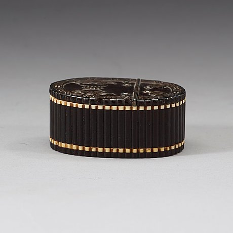 An ivory inlay silver decorated carved hardwood snuffbox, qing dynasty, 19th century.