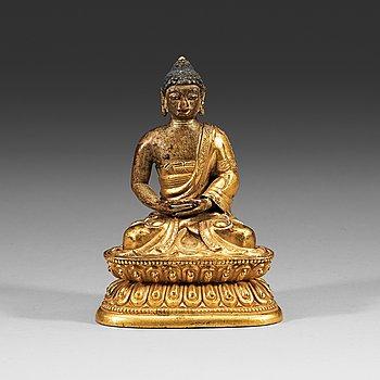 215. A Sino-Tibetan part-gilt bronze figure of Amitabha Buddha, 18th Century.