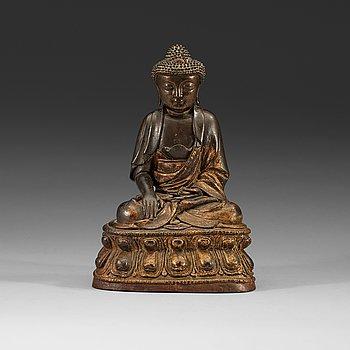 212. A gilt bronze figure of Buddha Sakyamuni, Ming dynasty (1368-1644).