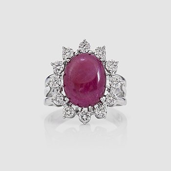 1439. A 10.00 ct untreated cabochon-cut ruby and brilliant-cut diamond ring. Total carat weight of diamonds 0.70 ct. GRS cert.