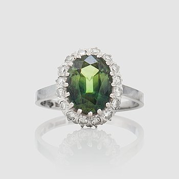 1428. A circa 3.56 ct yellowish-green sapphire and single-cut diamonds, total carat weight circa 0.31 ct.