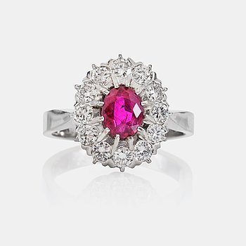 1427. A circa 1.00 ct ruby and 12 brilliant-cut diamonds, total carat weight circa 0.77 ct. Made by Stigbert, Stockholm.