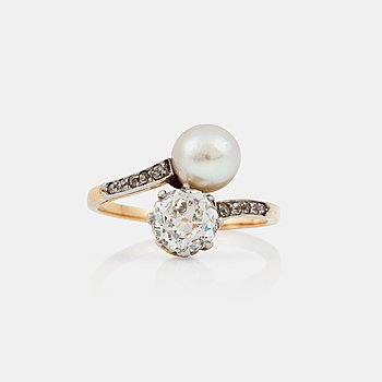 1107. A old-cut diamond, circa 1.10 ct H-I/VS, and pearl ring.