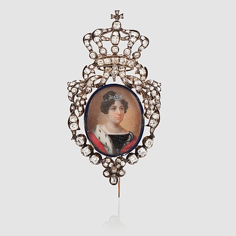A royal brooch with a painted miniature of queen desideria of sweden surrounded by blue enamel and antique-cut diamonds.