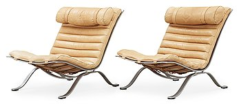 14. A pair of Arne Norell 'Ari' steel and leather easy chairs, Norell.