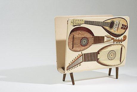 A piero fornasetti magazine rack, milano, italy 1950's.