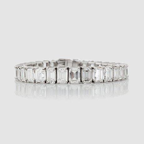 An emerald-cut diamond bracelet. total carat weight circa 30.00 cts.