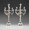 A pair of swedish 19th century silver candelabras, marks of gustaf möllenborg, stockholm 1845 and 1893.