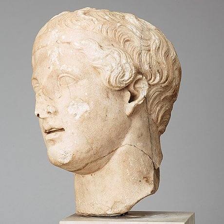 A marble portrait head of an athlet, roman 150 ad or later ie until modern times.