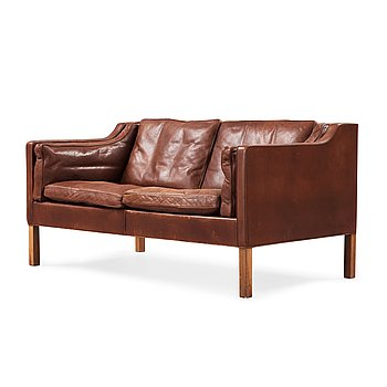 14. A Børge Mogensen two-seated dark brown leather sofa, Fredericia Stolefabrik, Denmark.
