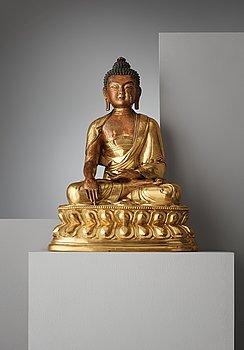 112A. A finely cast Tibeto-Chinese gilt bronze figure of Shakyamuni Buddha, Qing dynasty, circa 1800.