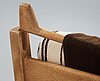 A pair of hans j wegner oak and fabric easy chairs, getama, gedsted, denmark 1950's-60's.