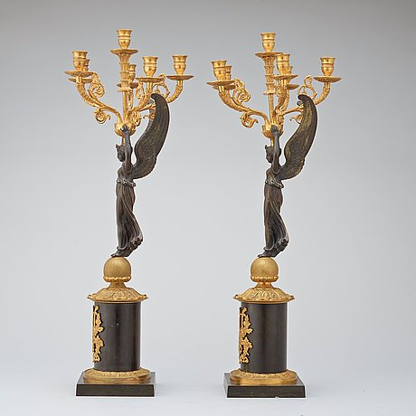 A pair of empire-style late 19th century six-light candelabra.